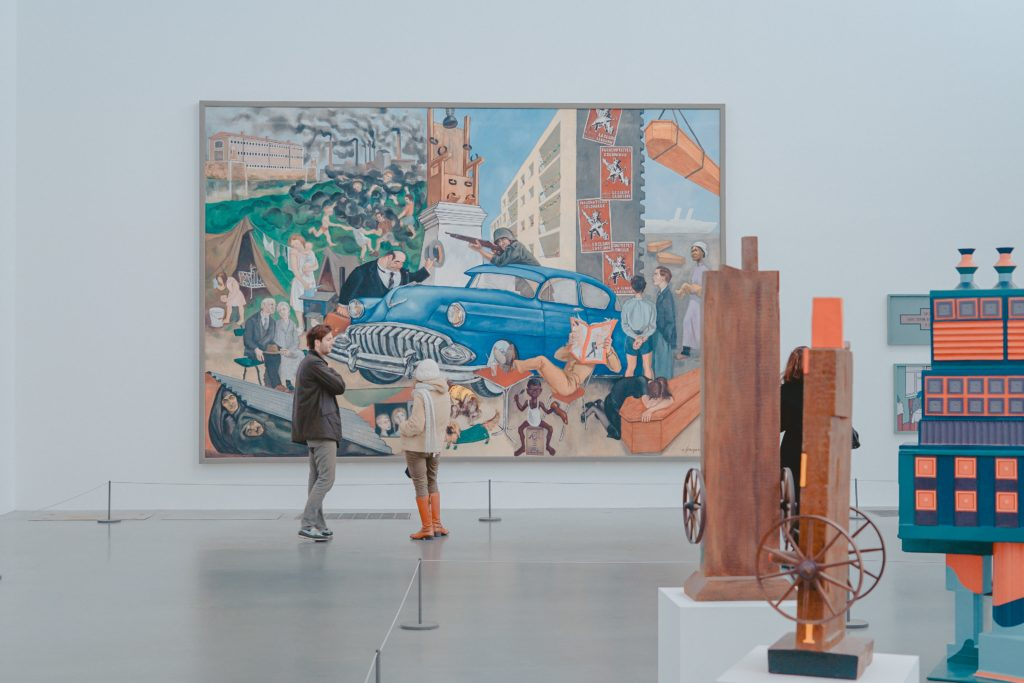 People discussing a painting